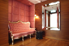 a red couch on a red upholstered wall (kunoan) Tags: digital hotel bay design interior hong kong gr interiordesign ricoh philippe jia causeway starch eyewashdesign