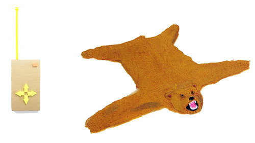 remote controlled bear skin rug and remote (collaged)