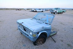 Fiat 128 (picturenarrative) Tags: auto california usa abandoned monument car death ruins fiat decay urbanexploration americana junkyard recycle derelict boneyard mojavedesert urbex 128 highway395 uer pearsonville automobilies