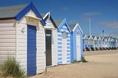 Elizabeth, Albert, Victoria & Shelley (Janet Marshall LRPS) Tags: blue white suffolk nikon dunes southwold beachhuts d300 18200mm