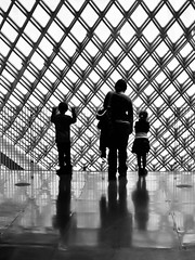 Women and Children First (Simple Insomnia) Tags: seattle family sky bw white abstract black reflection art public monochrome silhouette children blackwhite branch floor library central diamond seattlepubliclibrary centralbranch