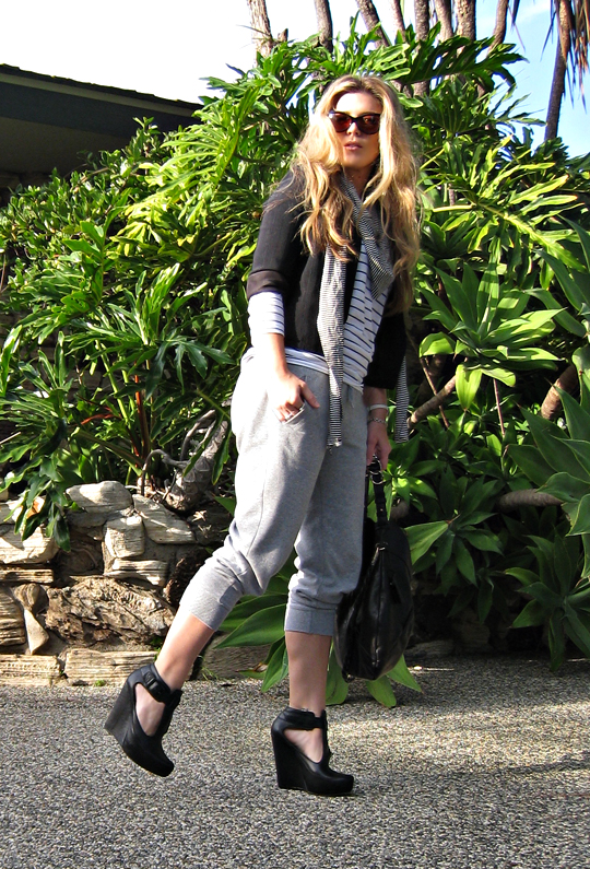 sweatpant fashion+black blazer+heels with sweatpants+striped top+cat eye sunglasses+ferragamo hobo+outfit
