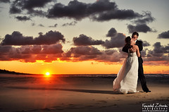 Kamila & Krzysztof (Krzysztof Zitarski) Tags: lighting wedding sunset clouds groom bride kissing couple dramatic session d90 3518 strobist