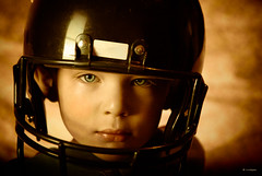 Determination (Rebecca812) Tags: family boy portrait cute vintage children football kid child play serious blueeyes helmet handsome son aged determined 3years determination canon5dmarkii familygetty2010 rebecca812