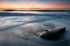 Sunset Surge, Windansea Beach (Nick Chill Photography) Tags: ocean california blue sunset orange motion blur beach water lines rock composition flow photography nikon surf waves glow pacific image sandiego dusk vibrant horizon fineart stock lajolla surfing slowshutter surfers rough windansea limitededitionprint d300s tokina1116mm nickchill darylbensenreversegrad