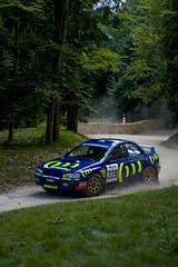 Subaru Impreza WRC (PeteWilliams) Tags: england cars car race canon geotagged sussex lenstagged europe westsussex rally subaru impreza goodwood 555 subaruimpreza goodwoodfestivalofspeed chrisatkinson canonefs1755mmf28isusm 400d eos400d canoneos400d eosdigitalrebelxti canon400d canoneosdigitalrebelxti