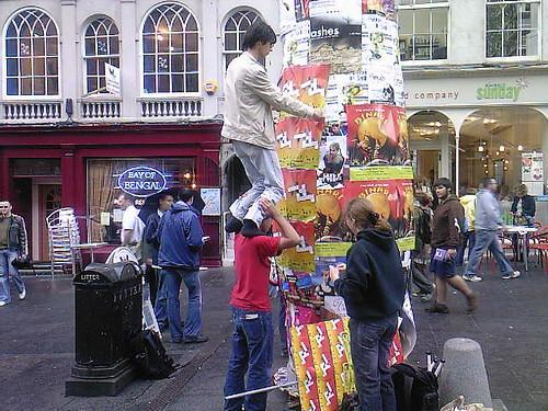 Tom balances on Yaz's shoulders