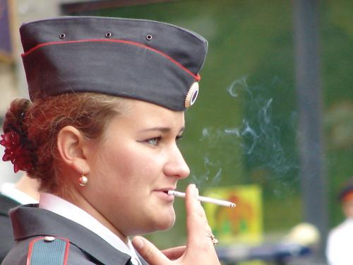 Russian Police Woman on duty in uniform smoking