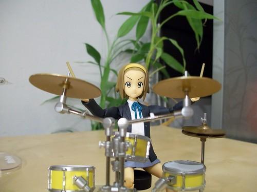 Ritsu behind her drum set
