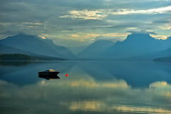 A Quiet Moment at Lake McDonald (Jeff Clow) Tags: morning vacation lake mountains reflection boat quiet silent serene glaciernationalpark 2010 lakemcdonald buoyant gapr buoyantspotlight