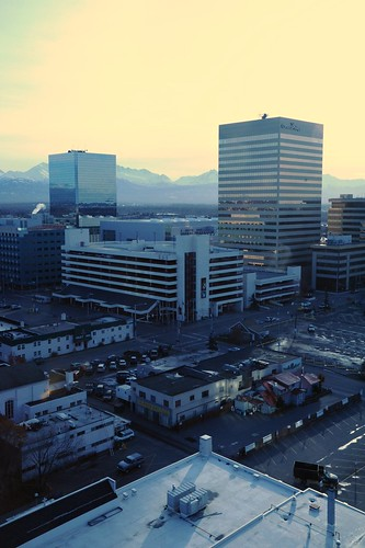 Horizontal lines of the buildings in downtown Anchorage and the Chugach Range from above, the 18th floor of the Captain Cook Hotel, Anchorage, Alaska, USA by Wonderlane