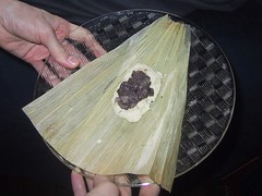 raw tamale, its dough and leaf