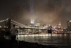 Looking at WTC Tribute in lights (noamgalai) Tags: park new york nyc bridge sky people lake ny newyork skyline brooklyn river photography photo memorial downtown remember worldtradecenter towers 911 battery picture twin 11 osama september photograph memory brooklynbridge terror twintowers wtc sept groundzero tributeinlight allrightsreserved 2007   photomania  noamg tributeinlights noamgalai   p1f1 aplusphoto wwwnoamgalaicom