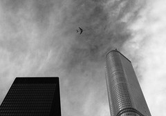 Sky Scrapers (cormend) Tags: light sky blackandwhite bw chicago abstract tower clouds skyscraper plane canon airplane eos fly office illinois midwest loop flight trump 50d cormend
