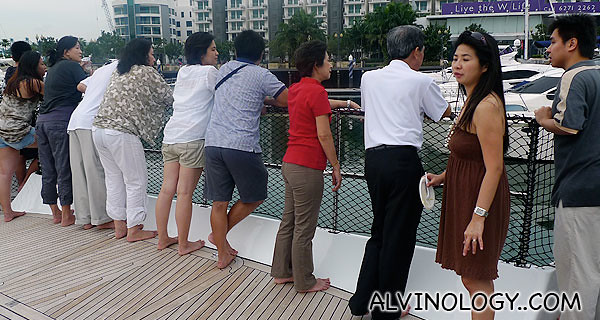 Everyone enjoying the breeze on our way back to Sentosa Cove