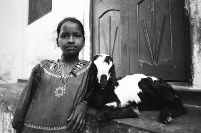 an Indian girl with a goat