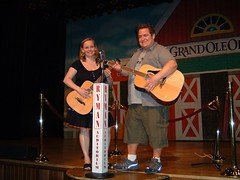 Christine and Tom on the stage of the Ryman.