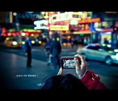 press the Button ! (d.r.i.p.) Tags: street travel light people usa ny newyork lights nikon dof bokeh manhattan drip explore timessquare 28 cinematic 2470mm d80 2470mmf28g