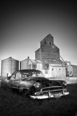 Forgotten (jsnowy2768) Tags: old winter sky rot abandoned broken car museum clouds blackwhite weeds rust montana antique forgotten brokendown scobey frontiertown