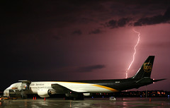 UPS DC-8 Lightning By The Tail (Kris Klop - clearskyphotography.com) Tags: aviation ups aircraft airplane plane douglas airport dc8 storm night lightning cargo nature watching naturewatcher diamondclassphotographer purple flickrdiamond dsm kdsm des moines desmoines