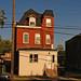 solitary, refurbished pullman row house
