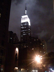 iPhone photo of the Empire State Building lit up at night, yo