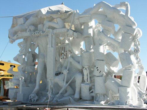 Monumental sculpture in Carrara marble showing a twenty characters nearing completion - rear view – Sandrine Vallée