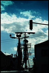 (Cybergabi) Tags: blue roof sky car clouds trafficlight silhouettes driveby bicycles explore 5f driverpic