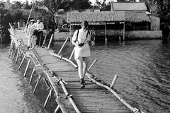 Hoi An Susie Bridge (Ian_Boys) Tags: bridge blackandwhite bw nikon asia 1999 bamboo vietnam hoian susie photoofaphoto f70 24120mm