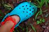 i love my crocs (flaming coppercat) Tags: blue orange india foot maharashtra karla lonavala anklet crocs diti flamingcoppercat