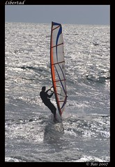 Libertad (rasbcn) Tags: barcelona espaa mar spain pentax playa viento surfing barceloneta silueta vela solitario k100d