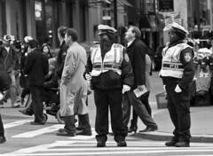 Squawk (Robbing Peter) Tags: nyc newyorkcity bw blackwhite downtown cops five police flags crosswalk walkietalkie
