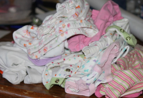 baby clothes waiting to be recycled