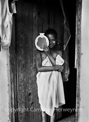 The Warm Heart of Africa - Malawi (Cameron Herweynen - photographer) Tags: world poverty life africa door wood travel light summer portrait people blackandwhite bw sun white house black art love me water girl monochrome beautiful beauty smile face silver way children fun shower happy photography hope mono mirror wooden eyes warm day peace village child hand heart natural bright african live joy young documentary social towel shy her creation human cameron malawi heat laugh strong enviromental nomads humanitarian doorframe portriat blantyre herweynen shortlisted tiredoftulips malawian