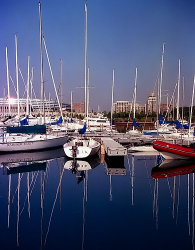 pictures city travel chicago reflection tourism reflections boats photography harbor illinois nikon sailing waterfront photos pics cities adventure reflected sailboats nikkor reflexions masts n90 burnham lakefront cookcounty chicagoland 28200mm travelphotography burnhamharbor cityphotography aplusphoto