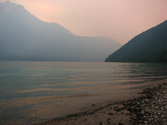 A smoky sunset (Is-epp) Tags: trees sunset sun lake mountains water clouds waves stones smoke hills rockymountains ripples keepexploring