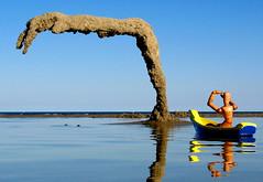 woody takes a closer look... (sandcastlematt) Tags: sculpture reflection castle beach toys boat sand massachusetts woody sandcastle sandsculpture toyboat sandhand bostonist duxbury duxburybeach universalhub adventuresofwoody submergedsandmonster notmybestsandcastleiadmit