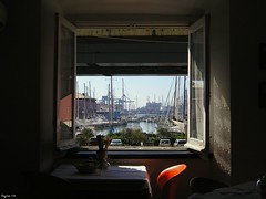 The Window on the Harbour...... (rogilde - roberto la forgia) Tags: travel light vacation italy orange window table book hp chair europa europe italia view liguria libro ombre finestra genova porto cover vista colori tavolo sedia soe arancio luce italians vocation copertina rivista portoantico supershot nikonstunninggallery platinumphoto