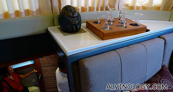 Ornamental Buddha and wine glasses