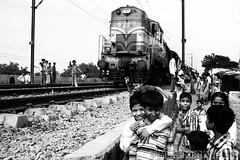 Living near the railway track (marcusfornell) Tags: india train children track delhi railway slum