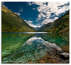 Jiuzhaigou :: The Rhinoceros Lake (DanielKHC) Tags: china blue sky lake water clouds digital 1 interestingness high nikon bravo rocks dynamic clear explore v valley transparency sichuan range jiuzhaigou dri hdr rhinoceros blending d300 jiuzhai danielcheong danielkhc vertorama tokina1116mmf28