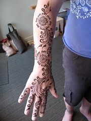henna (mehndi) flowers on the arm and hand of jen (HennaLounge) Tags: india flower yoga oakland hebrew om henna mehendi hindu priestess mehndi rockridge namaste