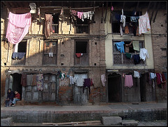 Clothes, Doors, windows, few families and.... One Rusty Building (Sukanto Debnath) Tags: nepal people building asian asia child sony mother clothes clothesline patan f828 nepali debnath sukanto sukantodebnath