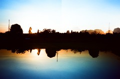 Flip the Evening Sky (Cloni) Tags: reflection nature xpro horizon olympus flip crossprocessing agfa agfaprecisa xa3 xprocessing precisa