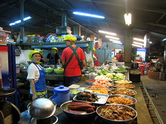 The Kitchen - a streetfood restaurant, basically (Boots in the Oven) Tags: street ladies food cooking smiling thailand outside happy restaurant women asia egg sausage flourescent bowls cooks kanchanaburi preparing chefs frying frontage