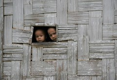 peeking out (janchan) Tags: portrait window children asia village bambini retrato documentary hut tribe ritratto soe bangladesh reportage marma flickrsbest chittagonghilltracts whitetaraproductions