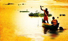 Fishing with Mr. Bose (Anoop Negi) Tags: travel blue sunset red portrait sky cloud india lake green bird tourism monument nature water beautiful yellow promotion clouds sunrise river landscape boat photo lomo fishing essay bravo moody fishermen faces image photos shots picture landmarks places kerala images location best exotic photograph journey land historical moods cochin anoop gree kochi boatman ernakulam oars outstanding negi waterscape uplifting kereala photosof magicdonkey thevera outstandingshots ezee123 thevara thavera abigfave anawesomeshot colorphotoaward irresistiblebeauty superbmasterpiece diamondclassphotographer imagesof