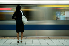 MRT Taipei (It's Stefan) Tags: blue urban woman motion travelling girl station train silver underground roc back interestingness mujer waiting asia asien chica publictransportation traffic gare metro  tube taiwan bahnhof stop transportation ubahn taipei asie mrt formosa  ilha parada nonluoghi pnv ilhaformosa  nonplace   madeintaiwan nonlieux  republicofchinataiwan  backsight stacin 1on1urbanphotooftheweek esperndo themetrains 1on1urbanphotooftheweekaugust2008 hltestelle asien  stefanhoechst stefanhchst