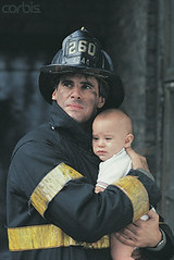 42-16149726 (Summer Discovery 2007) Tags: 2 portrait people baby men love children hugging toddler infant affection fear flame hero males whites 612months firefighting firefighter adults halflength assistance interaction facialexpression armaround