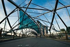 Inside The Helix (QooL / بنت شمس الدين) Tags: bridge building metal architecture skyscraper singapore stainlesssteel walkway link curved 9095 bayfront qool marinabay thehelix marinabaysands qoolens